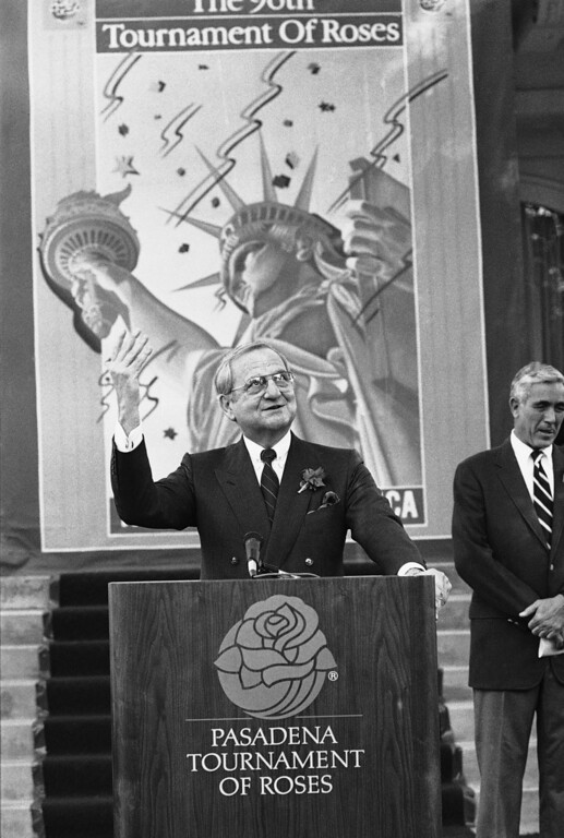 . Lee Iacocca, chairman and chief executive of Chrysler Corp., responds to questions in front of the Tournament House in Pasadena where he was named grand marshal of the 1985 Rose Parade by Tournament officials, Thursday, Oct. 18, 1984, Pasadena, Calif. (AP Photo/Wally Fong)