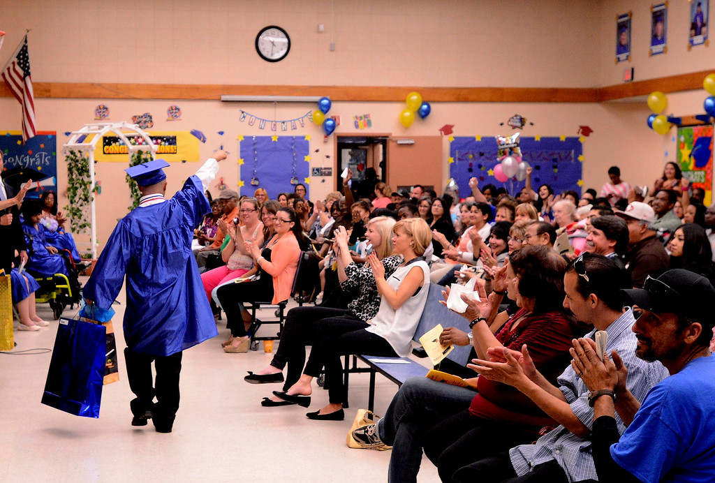 . A graduate celebrates during Commencement Ceremonies at Carl And Dora Anderson School in San Bernardino May 21, 2013.  GABRIEL LUIS ACOSTA/STAFF PHOTOGRAPHER.