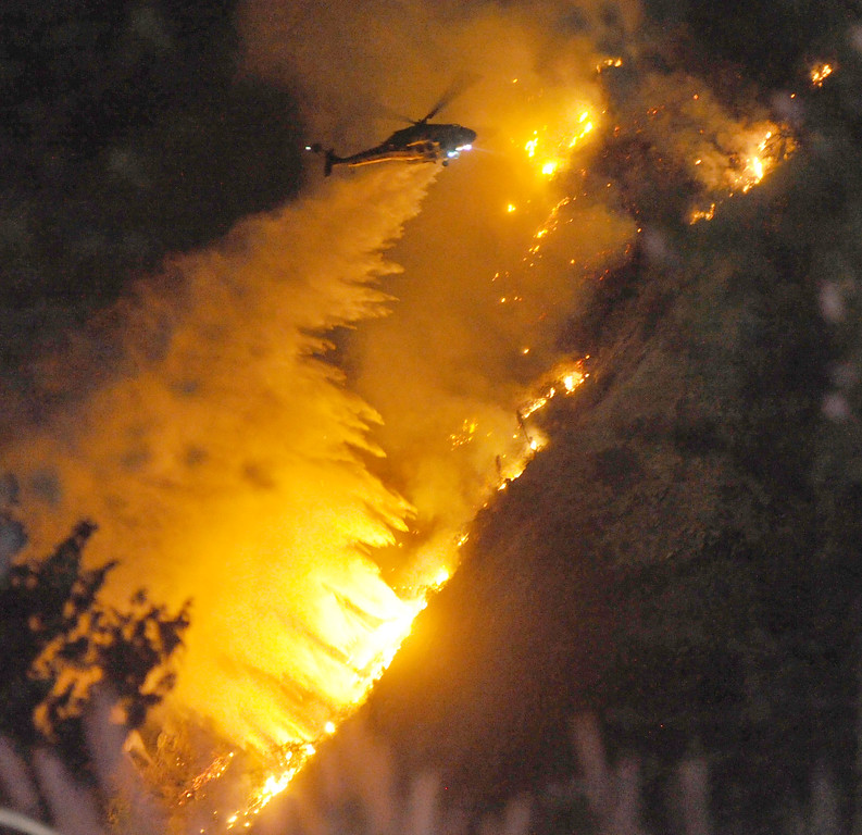 . A Los Angeles County Fire Department water dropping helicopter makes a night water drop to battle the Madre Fire in northwest of Highway 38 in Azusa on Monday September 23, 2013. (San Gabriel Valley Tribune/Staff Photo by Keith Durflinger)