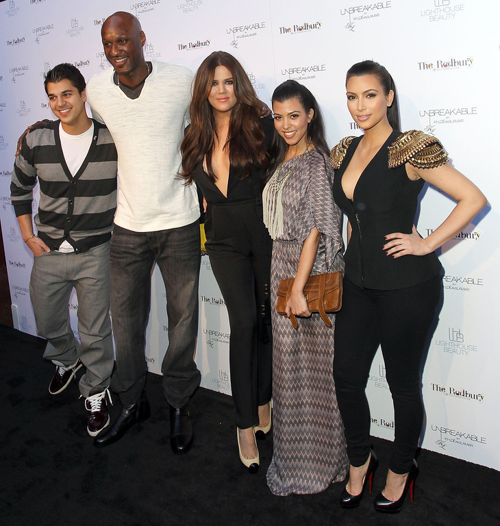 ". (L-R) Rob Kardashian, Lamar Odom, Khloe Kardashian Odom, Kourtney Kardashian and Kim Kardashian pose for photographers during the ""Unbreakable\"" Fragrance Launch at The Redbury, Los Angeles on April 4, 2011 in Los Angeles, California.  (Photo by Frederick M. Brown/Getty Images)"