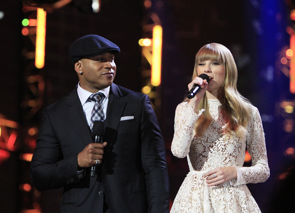 . Hosts LL Cool J, left, and Taylor Swift at the Grammy Nominations Concert Live! at Bridgestone Arena on Wednesday, Dec. 5, 2012, in Nashville, Tenn. (Photo by Wade Payne/Invision/AP)