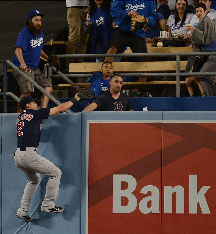 . The Red Sox\'s Jacoby Ellsbury #2 climbs the wall chasing the Dodgers\' Hanley Ramirez\'s #13  2-run homer in the 4th inning during their game  at Dodger Stadium Friday, August 23, 2013 in Los Angeles. (Hans Gutknecht/Los Angeles Daily News)