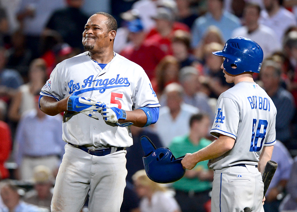 . Down runs Los Angeles Dodgers\' Juan Uribe heads to the outfield as he grounds out in the sixth as the Atlanta Braves defeat the Dodgers 4-3 in game 2 of the playoffs Thursday, October 4, 2013 at Turner Field in Atlanta, Georgia. (Photo by Sarah Reingewirtz/Pasadena Star- News)
