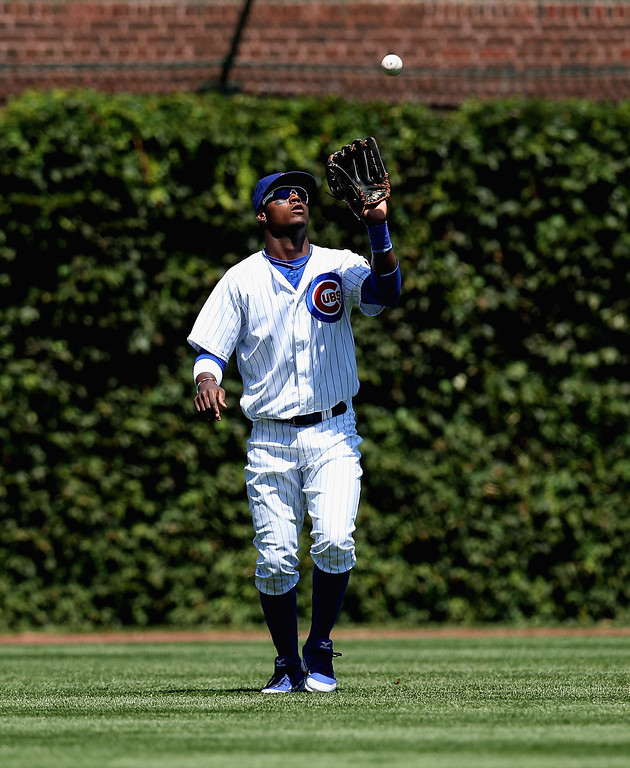 . CHICAGO, IL - AUGUST 04: Junior Lake #21 of the Chicago Cubs makes a catch against the Los Angeles Dodgers at Wrigley Field on August 4, 2013 in Chicago, Illinois. The Dodgers defeated the Cubs 1-0. (Photo by Jonathan Daniel/Getty Images)
