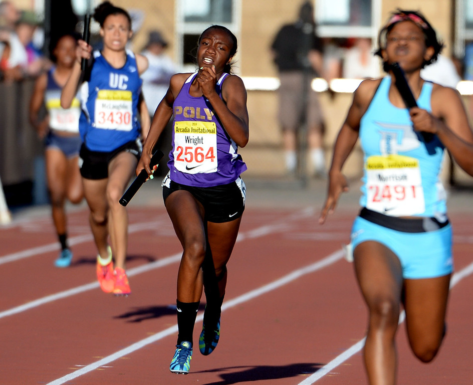 . Long Beach Poly\'s Autumn Wright competes in the 4x200 meter relay invitational during the Arcadia Invitational track and field meet at Arcadia High School in Arcadia, Calif., on Friday, April 11, 2014.  (Keith Birmingham Pasadena Star-News)