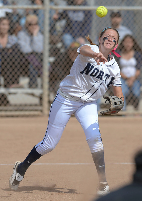 . North\'s Rachel Sandoval (5) rockets a throw to first on a Peninsula bunt in a first round CIF SS Division III softball game Thursday in Torrance. Peninsula won 4-1. 20130516 Photo by Steve McCrank / Staff Photographer