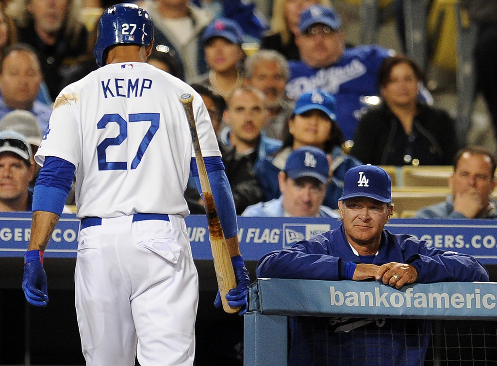 . Los Angeles Dodgers\' Matt Kemp (27) walks back into the dugout after striking out swinging with the bases loaded as manager Don Mattingly looks on in the seventh inning of their baseball game against the San Diego Padres on Wednesday, April 17, 2013 in Los Angeles.  Padrres won 7-2
