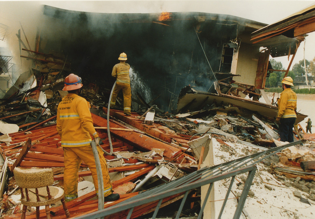 . Firemen put out a trailer home that burned in Sylmar, CA. 1/17/1994, photo by (John McCoy/Los Angeles Daily News)