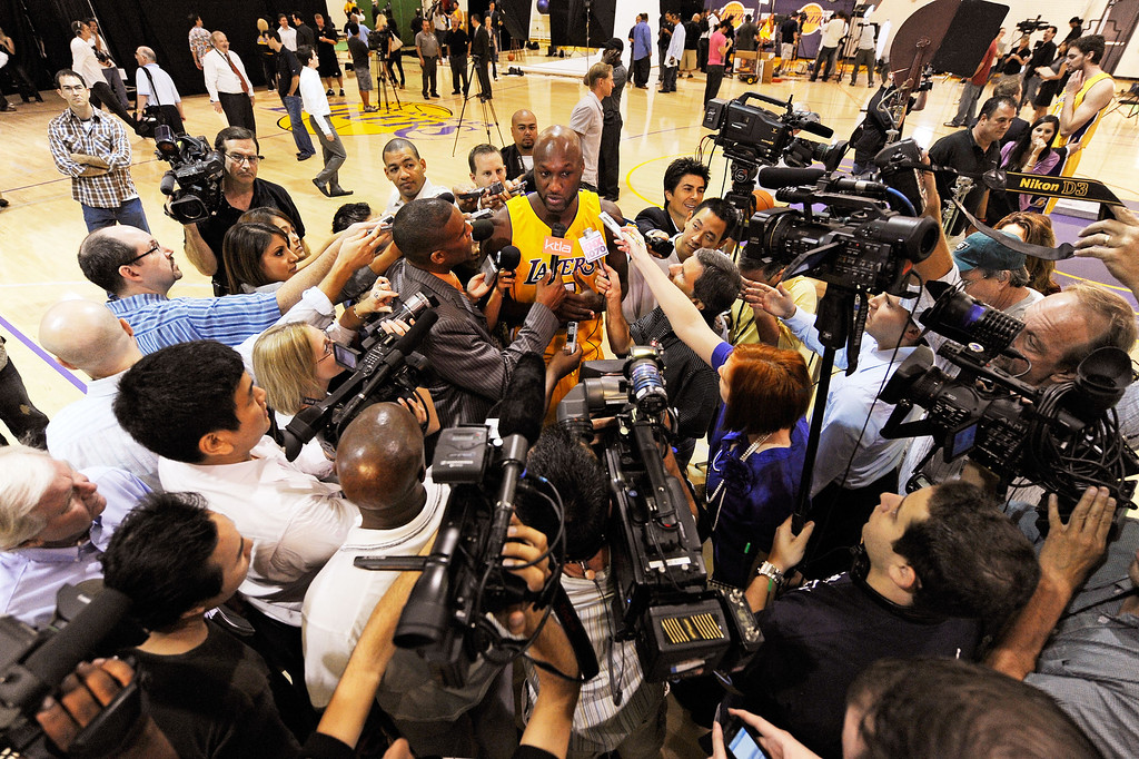 . Lamar Odom #7 (C) of the Los Angeles Lakers is surrounded by a crush of reporters during Lakers media day at the Lakers training facility on September 29, 2009 in El Segundo, California.    (Photo by Kevork Djansezian/Getty Images)