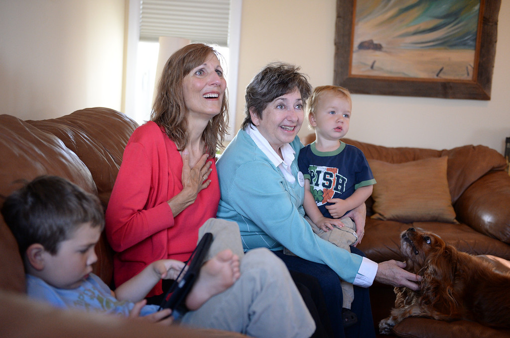 . Pat Alford-Keating (in red) and Shannon Keating, a married Redondo Beach couple, watch news reports of the Supreme Court decisions regarding Proposition 8 and  DOMA. Aidan, 5 and Orion, 3 are their grandchildren  Photo by Brad Graverson 6-26-13