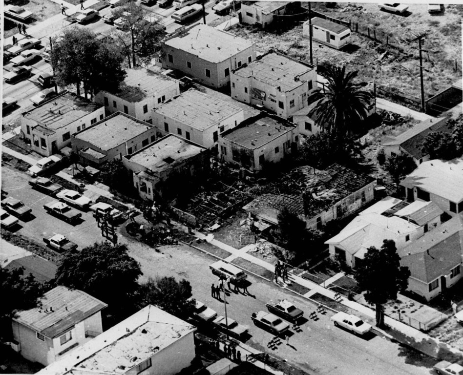 . This is an aerial view showing the burned remains of a South-Central Los Angeles house where six suspected members of the Symbionese Liberation Army died late Friday May 18, 1974, during a shootout with police and FBI agents. This was the result of the robbery of the Hibernia Bank in San Francisco by the SLA. (AP Photo)