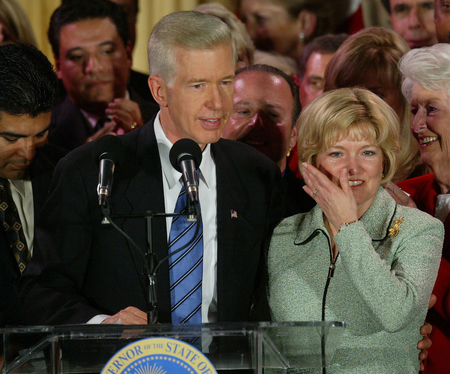 . 10/7/03- Los Angeles, CA  Governor Gray Davis speaks to his supporters as Sharon wipes her tears after conceding the Governor\'s position to Arnold Schwarzeneger (please correct spelling) in the Crystal Ballroom of the Biltmore Hotel in Los Angeles. John Lazar/L.A. Daily News