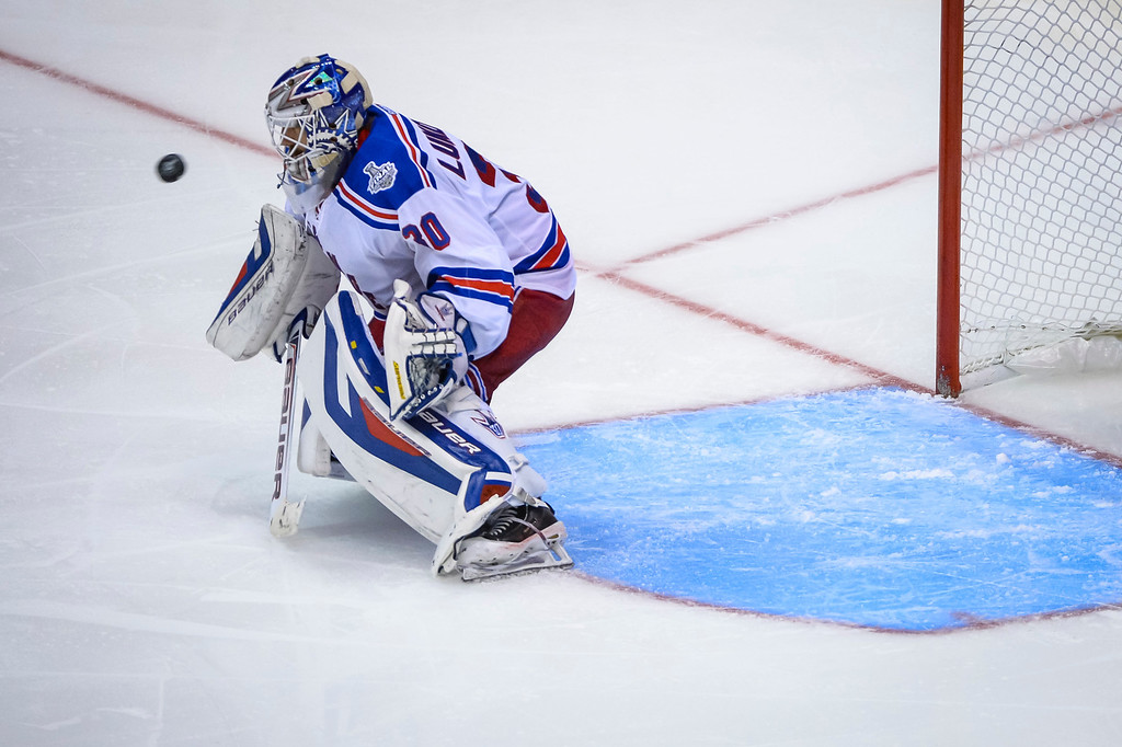 . Rangers Henrik Lundqvist couldn\'t stop this shot by Justin Williams in overtime to win Game 1 of the Stanley cup Finals at Staples Center Wednesday, June 4, 2014  Kings won the game  3-2.   ( Photo by David Crane/Los Angeles Daily News )