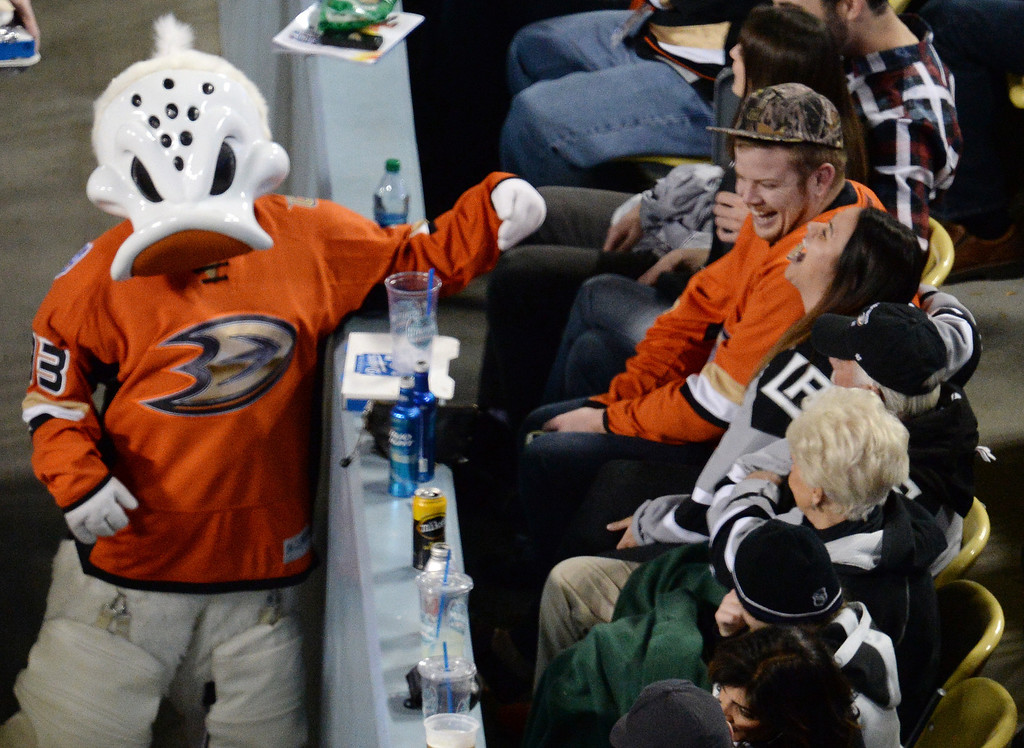 . The Ducks� mascot has some fun with fans during the 2014 NHL Stadium Series featuring the Los Angeles Kings taking on the Anaheim Ducks at Dodger Stadium January 25, 2014. (Photo by Hans Gutknecht/Los Angeles Daily News)