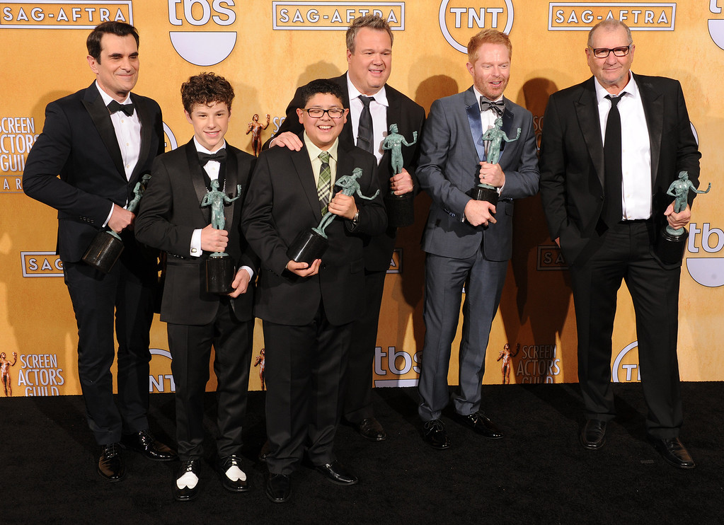. The men from Modern Family Ty Burrell, Nolan Gould, Rico Rodriguez, Eric Stonestreet, Jesse Tyler Ferguson, Ed O\'Neill backstage at the 20th Annual Screen Actors Guild Awards  at the Shrine Auditorium in Los Angeles, California on Saturday January 18, 2014 (Photo by John McCoy / Los Angeles Daily News)