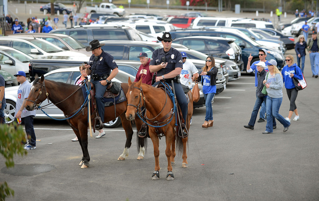 . LAPD officers on horseback patrol the parking lot on opening day at Dodger Stadium April 1, 2013.  The Dodgers hosted the San Francisco Giants.(Andy Holzman/Staff Photographer)