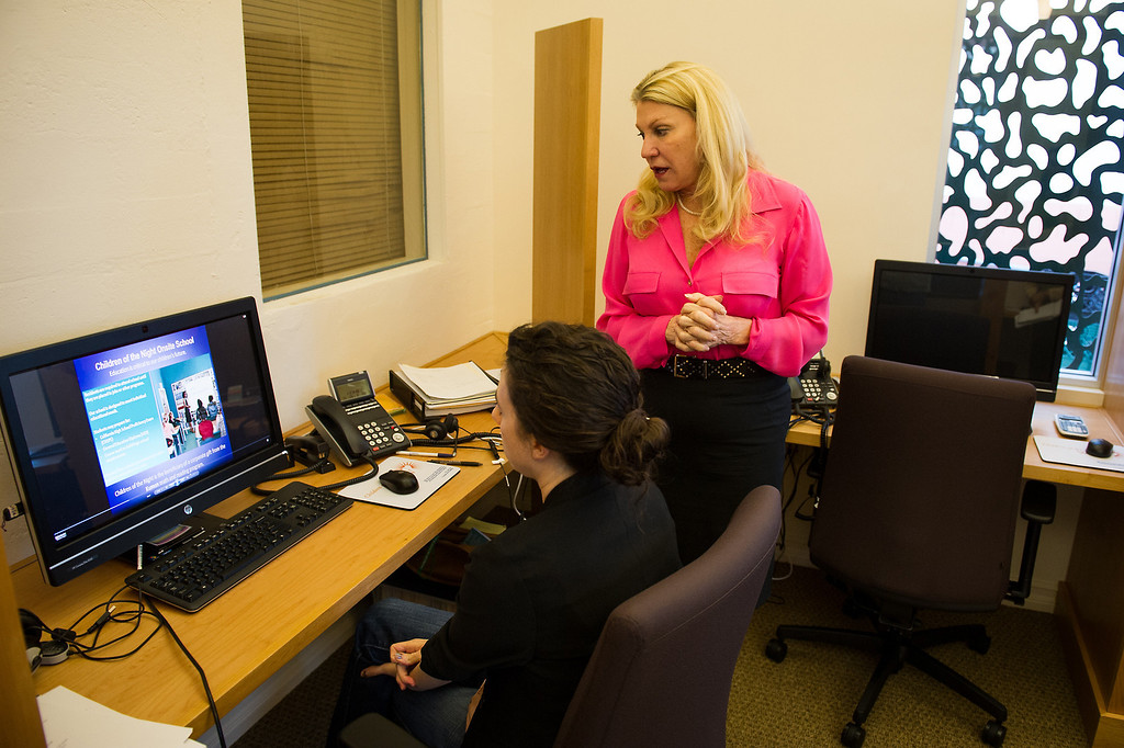. Lois Lee, right, founder and president of Children of the Night, stands by Maddie Maradiegue director of online education, in a new call center at Children of the Night in Van Nuys. Monday, March 17, 2014. (Photo by Michael Owen Baker/L.A. Daily News)