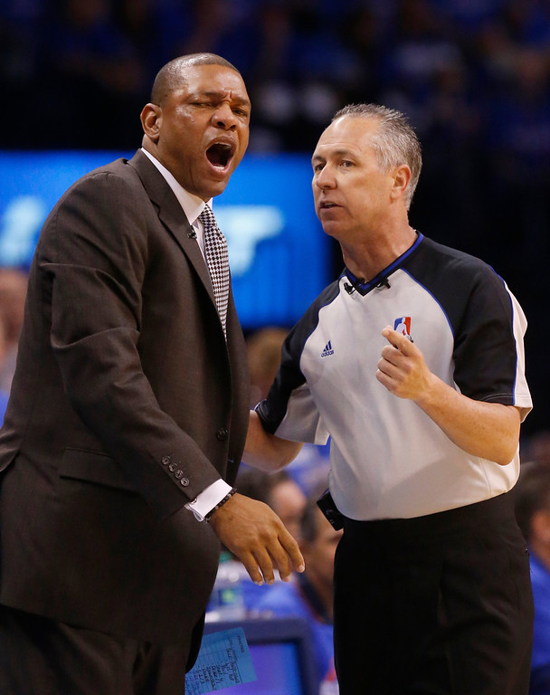 . Los Angeles Clippers head coach Doc Rivers, left, reacts to a call by official Eric Lewis, right, in the first quarter of Game 1 of the Western Conference semifinal NBA basketball playoff series against the Oklahoma City Thunder in Oklahoma City, Monday, May 5, 2014. (AP Photo/Sue Ogrocki)