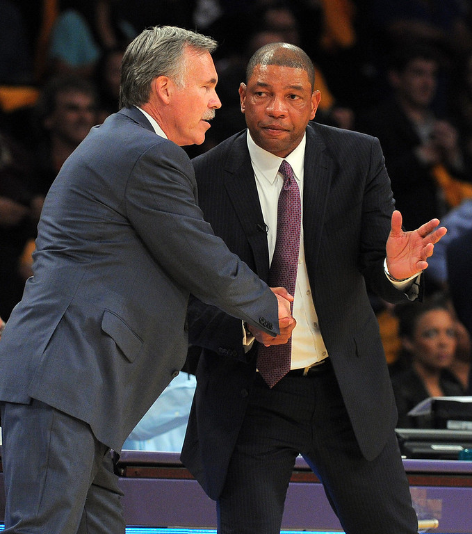. Lakers coach Mike D\'Antoni, left, and Clippers coach Doc Rivers greet each other at the end of the game in the NBA season opener between the Lakers and Clippers at Staples Center in Los Angeles, CA on Tuesday, October 29, 2013. 