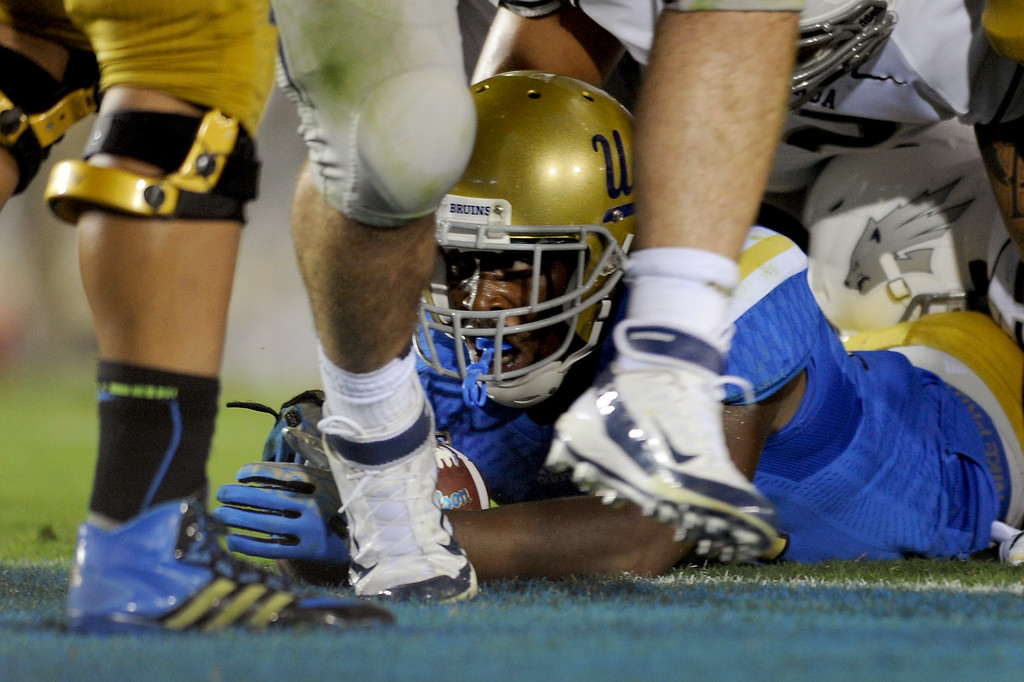 . UCLA RB Paul Perkins goes for a three-yard touchdown run in the fourth quarter against Nevada, Saturday, August 31, 2013, at the Rose Bowl. (Michael Owen Baker/L.A. Daily News)