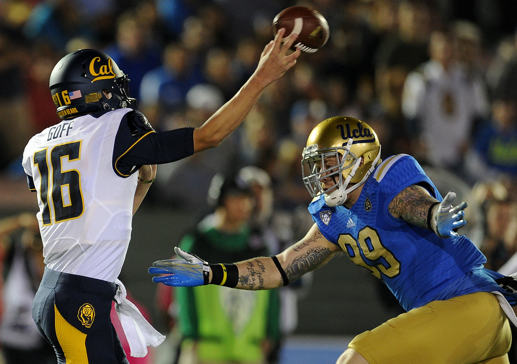 . UCLA defensive end Cassius Marsh (99) pressures California quarterback Jared Goff (16) during the first half of their college football game in the Rose Bowl in Pasadena, Calif., on Saturday, Oct. 12, 2013.   (Keith Birmingham Pasadena Star-News)