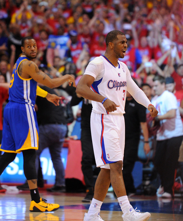. Clippers\' Chris Paul celebrates their 126-121 win over the Warriors in game seven of the Western Conference playoffs, Saturday, May 3, 2014, at Staples Center. (Photo by Michael Owen Baker/L.A. Daily News)