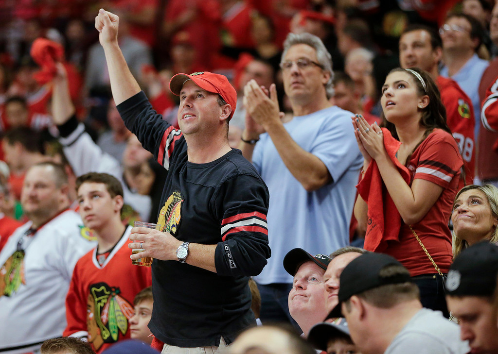 . Chicago Blackhawk fans cheer after the Blackhawks defeated the Los Angeles Kings 2-1 in Game 1 of the NHL hockey Stanley Cup Western Conference finals, Saturday, June 1, 2013, in Chicago. (AP Photo/Nam Y. Huh)