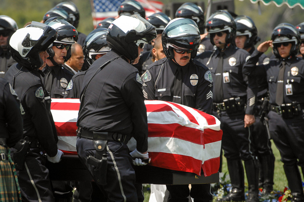 . Honorary pallbearers carry the casket of LAPD officer Chris Cortijo, Tuesday, April 22, 2014, at Forest Lawn Hollywood Hills. (Photo by Michael Owen Baker/L.A. Daily News)