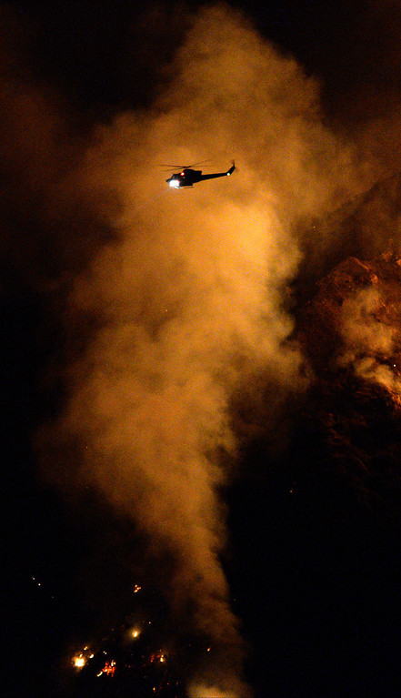 . Fire helicopters make water drops brush fire broke out in the Angeles National Forest above Azusa Monday afternoon. The fire was burning west of San Gabriel Canyon Road (State Route 39) and uphill away from structures. As of 11 p.m., the fire charred about 190 acres and was 5 percent contained.  There was no immediate threat to residences. Structure protection was underway just in case. Azusa CA. Sept 23,2013. Photo by Gene Blevins/LA DailyNews