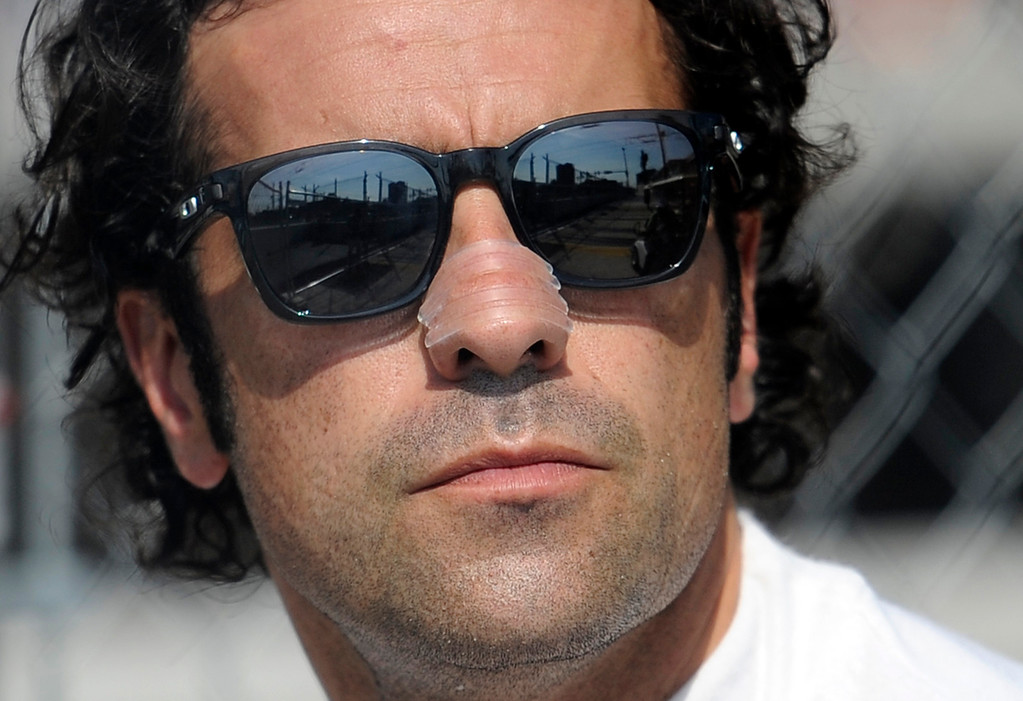 . Dario Franchitti, of Scotland, watches a warm up session for the IndyCar Grand Prix of Baltimore auto race, Sunday, Sept. 1, 2013, in Baltimore. (AP Photo/Nick Wass)