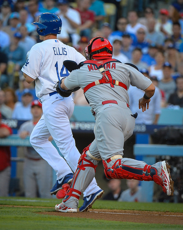 . Cardinals\' Yadier Molina runs down Dodgers\' Mark Ellis for an out in the NLCS game 3 at Dodger Stadium Monday, October 14, 2013 ( Photo by Andy Holzman/Los Angeles Daily News )
