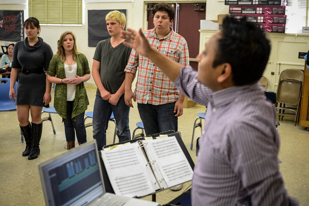 . Choir director Daniel Lopez, right, works with the Verdugo Hills High School Chorus after school on Tuesday, February 26, 2014.  The group will be one of the LAUSD groups to perform at the Arts Fest at Grand Central Park in Los Angeles on March 15th. (Photo by David Crane/Los Angeles Daily News)