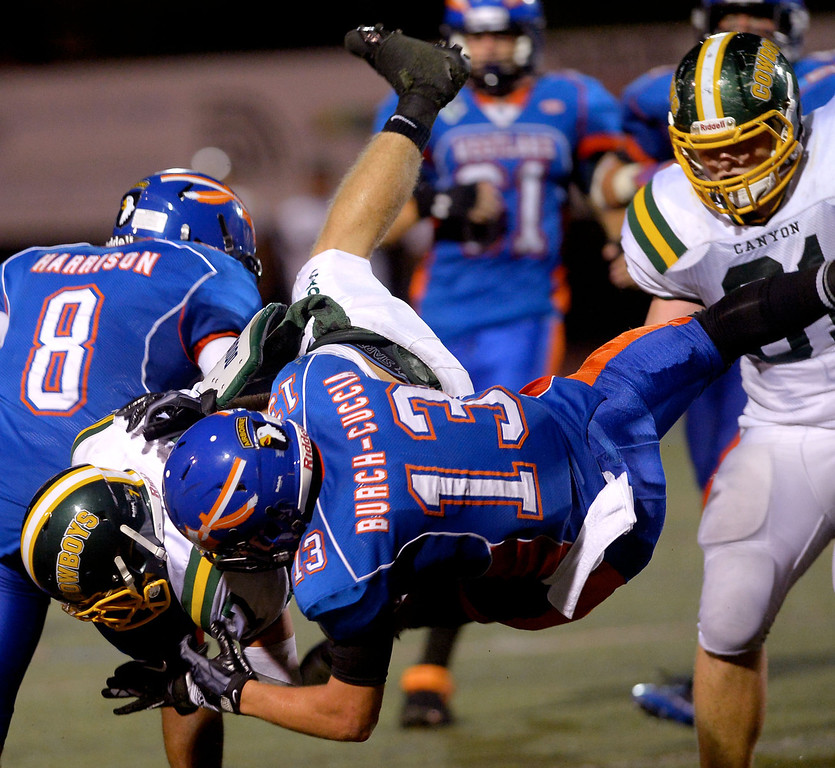 . Canyon High School ball carrier Zach Cuha is brought down by Westlake High\'s	Jesse Cuccia August 30, 2013 in Westlake Village, CA.(Andy Holzman/Los Angeles Daily News)