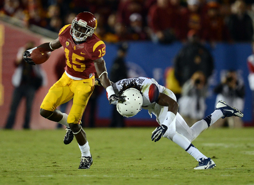 . USC\'s  Nelson Agholor #15 pushes away Arizona\'s Jonathan McKnight #6 after hauling in a pass during their game at the Los Angeles Memorial Coliseum Thursday, October 10, 2013. (Photo by Hans Gutknecht/Los Angeles Daily News)
