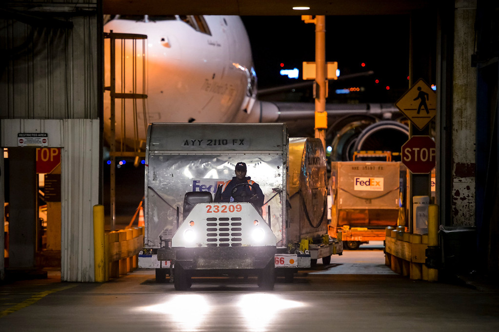 ". Cargo containers loaded with packages are brought off jets at the FedEx LAX Regional Hub to be distributed to Southern California on ""Cyber Monday\"", December 2, 2013.  (Photo by David Crane/Los Angeles Daily News)"