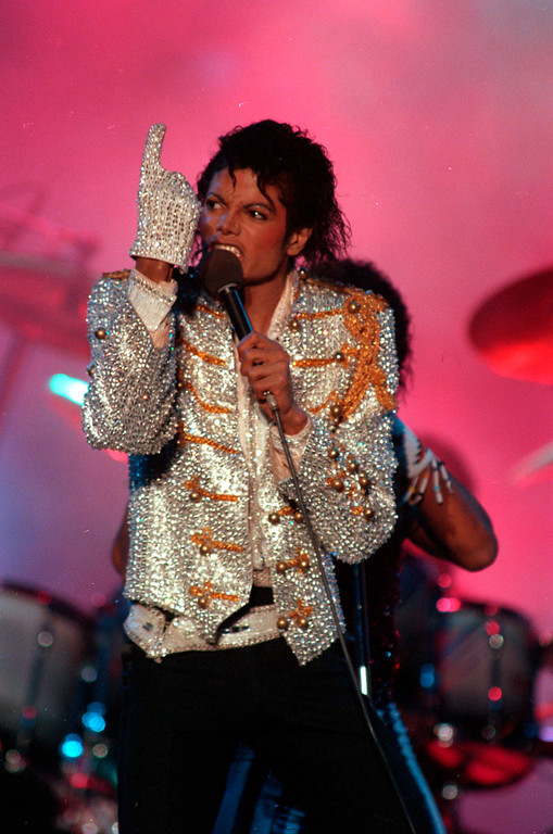 . In this Dec. 3, 1984 picture, Michael Jackson performs with his brothers at Dodger Stadium in Los Angeles as part of their Victory Tour concert. (AP Photo/Doug Pizac)