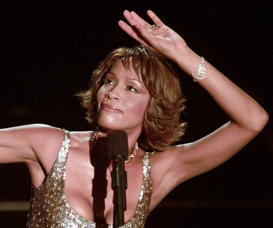 """. Entertainer Whitney Houston strikes a pose during her performance at the Shrine Auditorium in Los Angeles, Monday, April 10, 2000,  during taping of the \""""25  (AP Photo/Mark J.Terrill)"""