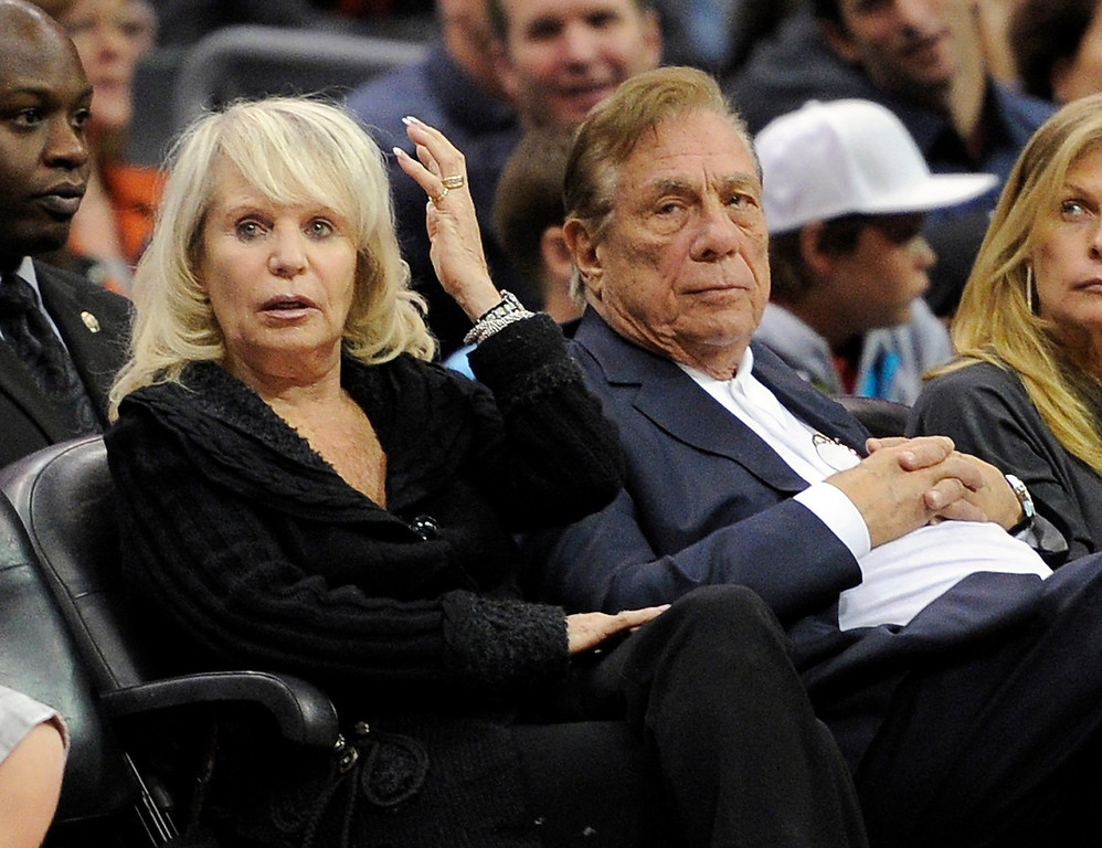 . Los Angeles Clippers owner Donald T. Sterling, right, sits with his wife Rochelle during the Clippers NBA basketball game against the Detroit Pistons, Friday, Nov. 12, 2010, in Los Angeles. The Pistons won 113-107.(AP Photo/Mark J. Terrill)