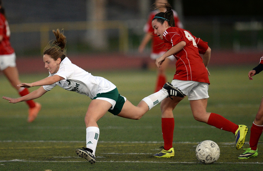 . Canyon\'s Shanell Alexander #5  gets tripped up by  Lancaster\'s Natalie Mitchell #4 during their girls soccer game at Canyon High School in Santa Clarita Thursday, January 9, 2014.  (Photo by Hans Gutknecht/Los Angeles Daily News)
