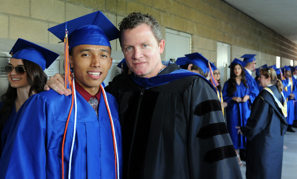 . Dr. Ross Porter poses with a student before the graduation ceremony.  Chaminade College Preparatory High School, celebrating its 60th anniversary, graduated 337 students at the West Hills campus on Saturday, June 01, 2013.  (Dean Musgrove/Los Angeles Daily News)