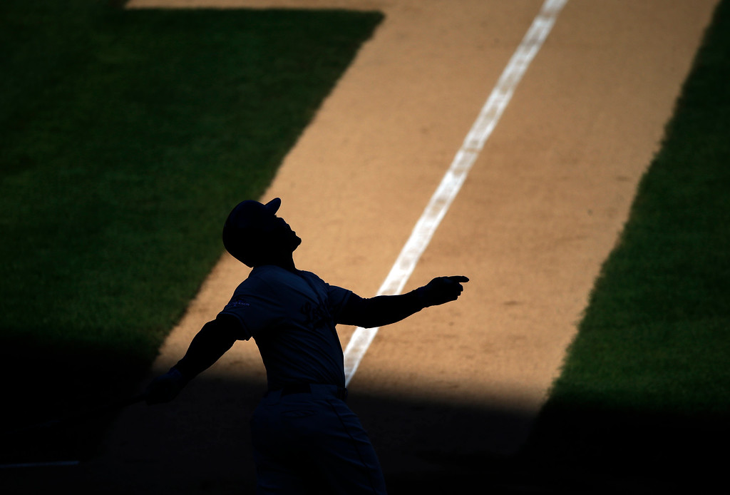 . Los Angeles Dodgers\' Carl Crawford hits during the first inning of Game 2 of the National League baseball championship series against the St. Louis Cardinals Saturday, Oct. 12, 2013, in St. Louis. (AP Photo/Charlie Neibergall)