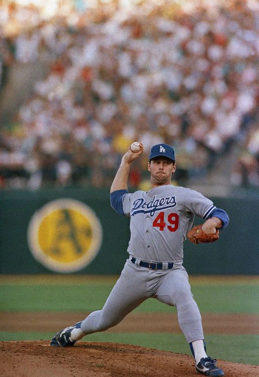 . Los Angeles Dodgers Tim Belcher (49) pitches against the Oakland As in first inning action of the fourth game of the World Series at Oakland Coliseum, Wednesday, Oct. 19, 1988, Oakland, Calif. (AP Photo/Lennox McLendon)