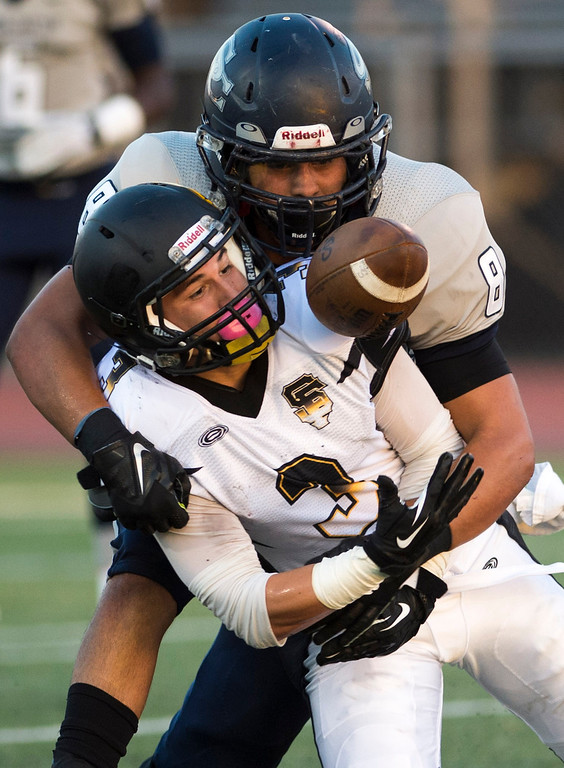 . San Fernando\'s Jose Camargo #3 hauls in a pass as Sierra Canyon\'s Justin Escudero #8 defends during their game against  at Granada Hills High School in Granada Hills Friday, August 30, 2013. (Hans Gutknecht/Los Angeles Daily News)