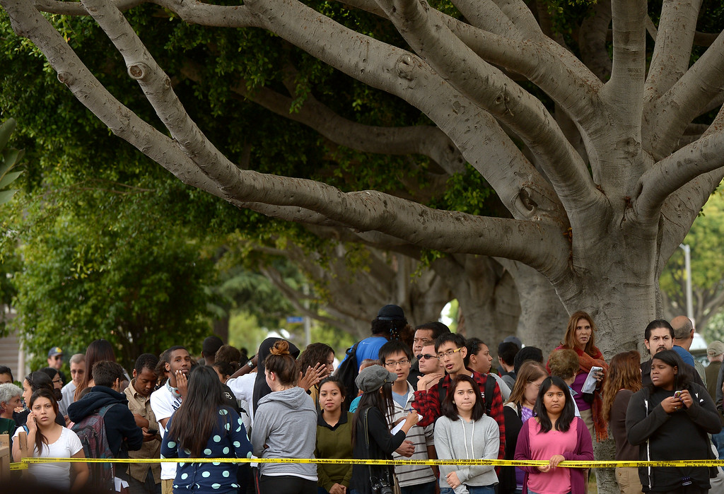 . Students wait outside the grounds of Santa Monica College after multiple shootings were reported on the campus June 7, 2013 in Santa Monica, California. At least six people died in the shooting rampage before police shot and killed a black-clad gunman in the college library, police said.  (JOE KLAMAR/AFP/Getty Images)