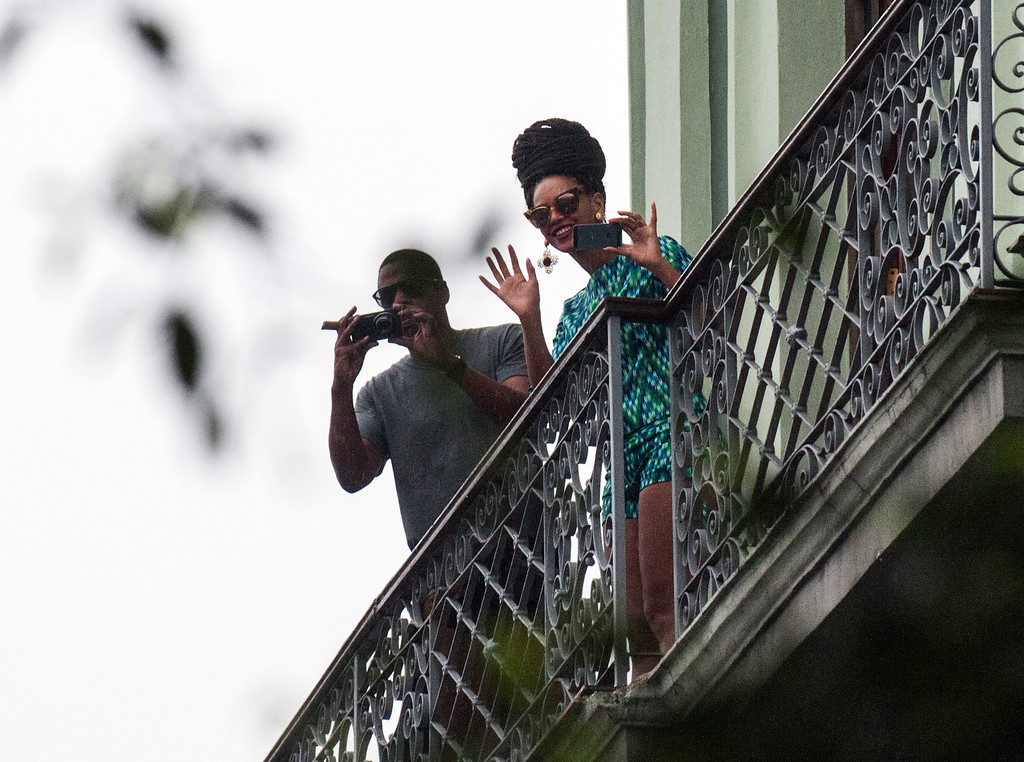 . US singer Beyonce is seen in a balcony of the Saratoga Hotel in Havana next to her husband Jay Z, on April 5, 2013. Pop diva Beyonce and her rapper husband Jay-Z on Thursday created a stir as they toured the streets of Old Havana, with hundreds of Cubans turning out to catch a glimpse of the US power couple.           (STR/AFP/Getty Images)