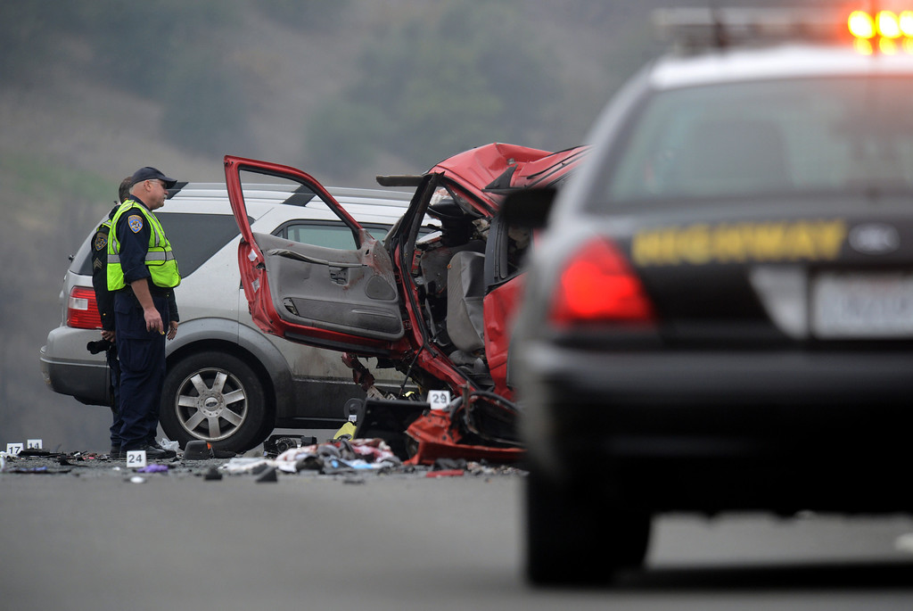 . CHP investigates the scene of a fatal traffic collision, where six people were killed, involving a wrong way driver on the westbound 60 freeway in Diamond Bar, CA., Sunday, February 9, 2014.