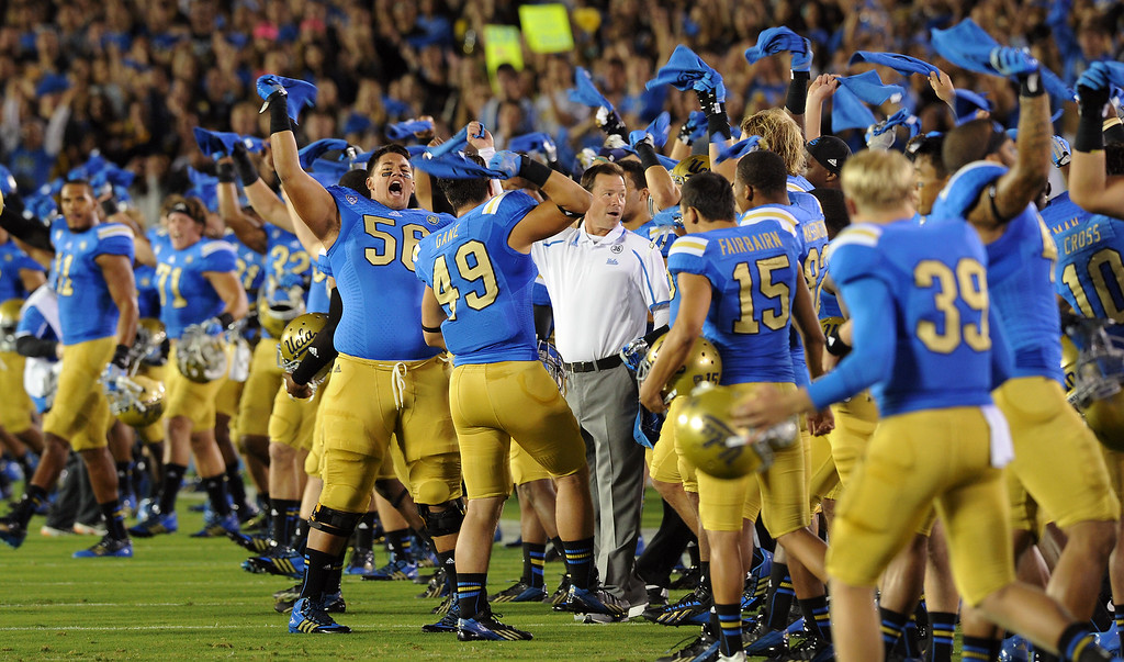 . The UCLA team cheers after a moment of silence before their game against New Mexico State, Saturday, September 21, 2013, at the Rose Bowl, to honor teammate Nick Pasquale who was killed when struck by a car September 8. (Photo by Michael Owen Baker/L.A. Daily News)