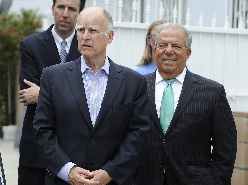 . LONG BEACH, CALIF. USA -- Gov. Jerry Brown, left, with Long Beach Mayor Bob Foster, before brown speaks at a north Long Beach (Calif.) home during a solar installation on Friday, May 17, 2013. This is the sixth family on this North Long Beach block to be assisted by the Single-family Affordable Solar Homes Program. This installation will allow the homeowners to save up to 90% on their electricity bills. Photo by Jeff Gritchen / Los Angeles Newspaper Group