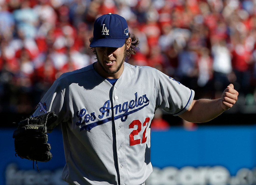 . Los Angeles Dodgers starting pitcher Clayton Kershaw punches the air after getting St. Louis Cardinals\' Yadier Molina to fly out during the first inning of Game 2 of the National League baseball championship series Saturday, Oct. 12, 2013, in St. Louis. (AP Photo/David J. Phillip)