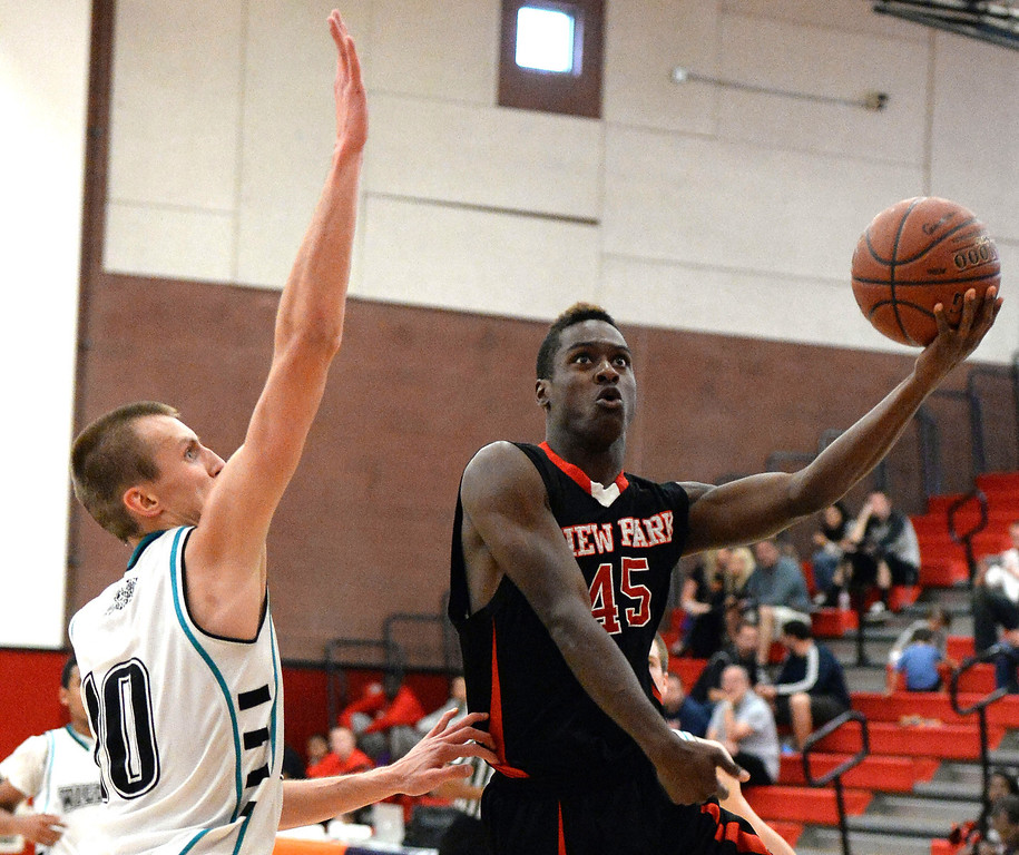 . View Park\'s Luis Medearis (45) drives past Renaissance Academy \'s Marty Gaizauskas (10) in the first half of a CIF Southern California Regional Division basketball game at Colony High School in Ontario, Calif., on Saturday, March 22, 2014.  (Keith Birmingham Pasadena Star-News)